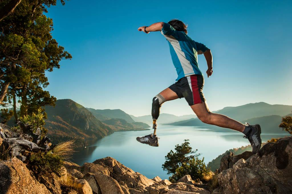 man jumping from one rock to another with a prosthetic leg - Silipos - Polymer gel foot support inserts and prosthetics for an active lifestyle